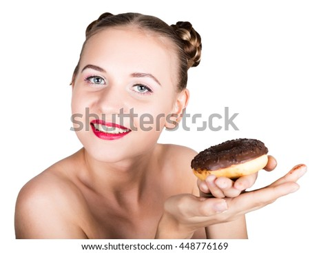 girl in bright makeup eating a tasty donut with icing. Funny joyful woman with sweets, dessert. dieting concept. junk food. girl with tenderness looks at a donut - stock photo