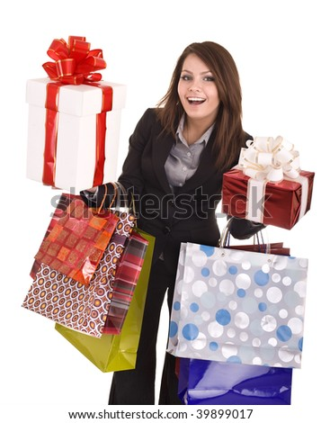 Girl in business suit with group  gift box and  bag.  Isolated.