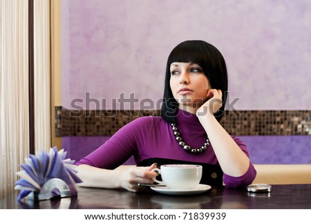 girl in cafe with coffee cup - stock photo