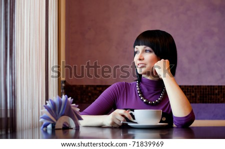 girl in cafe with coffee cup smiling - stock photo