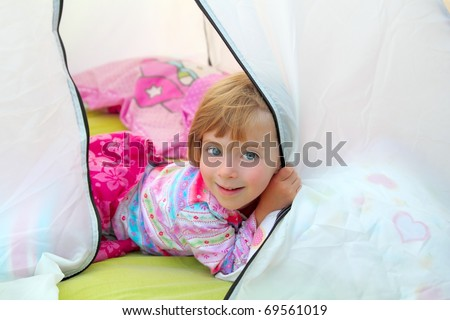 girl in camping tent lying happy on camp tent - stock photo