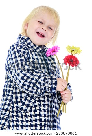 Girl in checkered coat with a bouquet of flowers.Isolated on white background studio photo.
