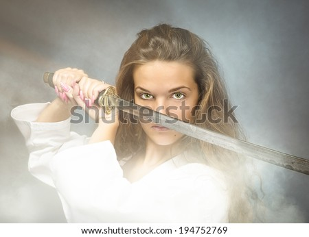 girl in cinematic samurai action - stock photo