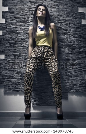 Girl in clothes with leopard print - stock photo