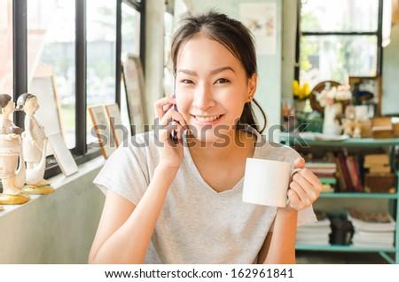 Girl in coffee shop - stock photo