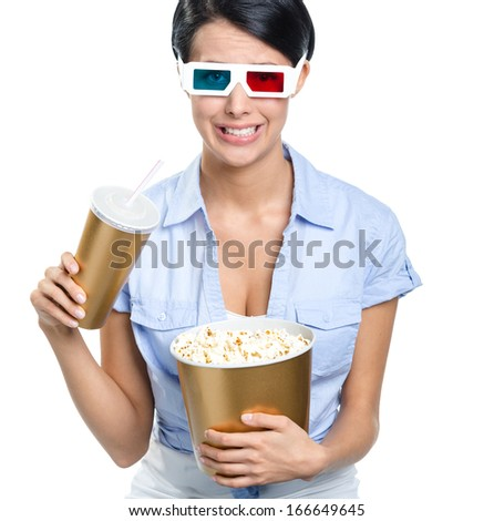 Girl in 3D glasses drinking beverage with bowl of popcorn and watching movie, isolated on white - stock photo