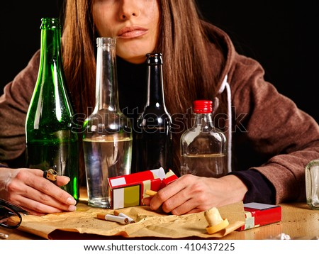 Girl in depression drinking alcohol. Drinking habits. - stock photo