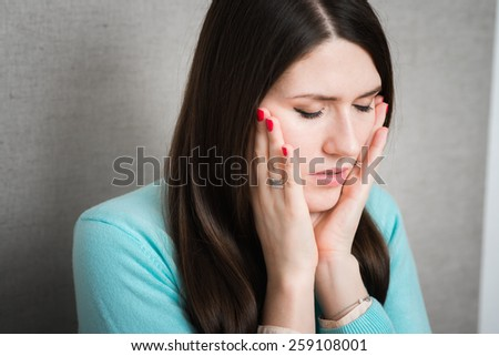girl in despair with his eyes closed - stock photo