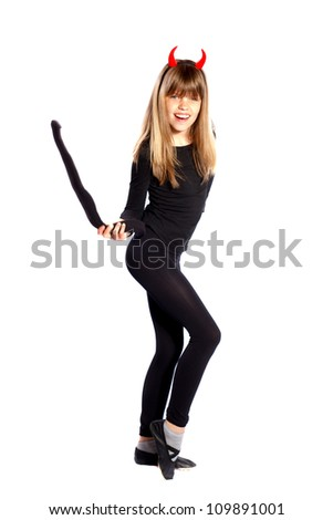 girl in devil costume waving his tail on a white background - stock photo