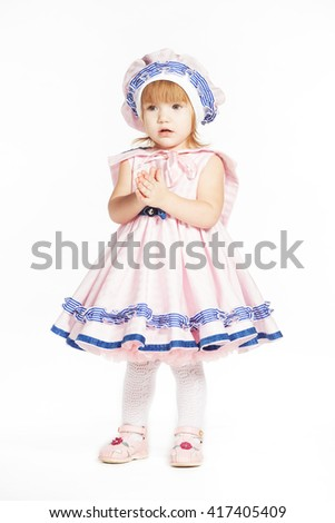 Girl in dress like sailor - stock photo
