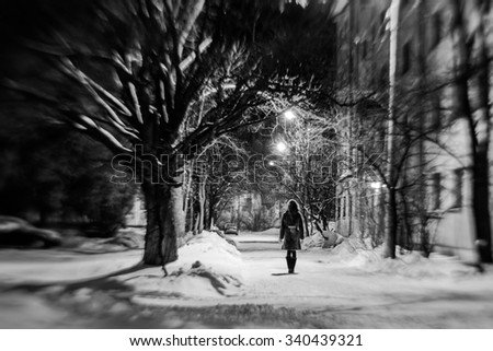 Girl in empry street at the dark night blur - stock photo