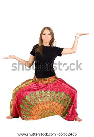 Girl in ethnic clothes studio shot - stock photo