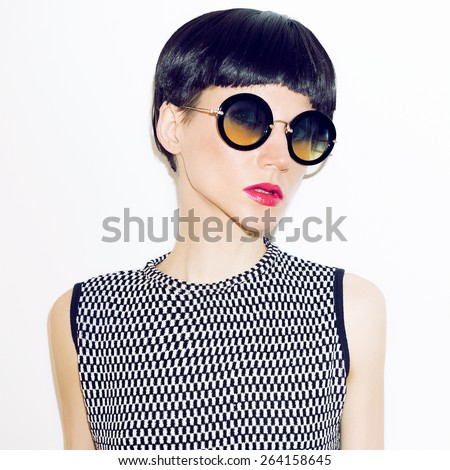 Girl in fashion Sunglasses and trendy short Haircut. - stock photo
