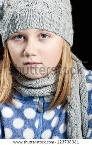 Girl in fashionable winter clothes