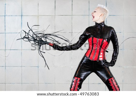 Girl in fetish suit. Fetish concept. - stock photo