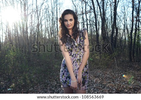 girl in floral dress in the woods - stock photo