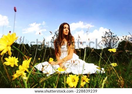 Girl in flower field  - stock photo