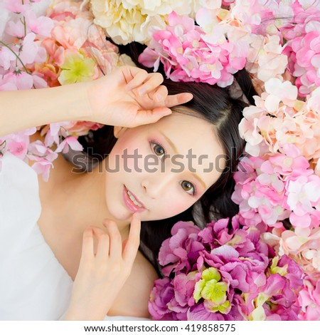 Girl in flower good sleep / sakura - stock photo