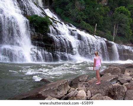 Girl In Front Of Waterfall - stock photo