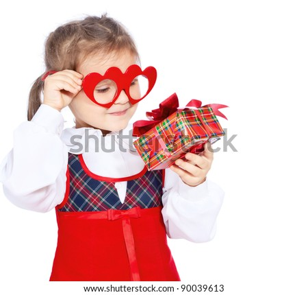 girl in glasses with a gift on a white background - stock photo