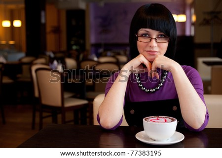 girl in glasses with coffe - stock photo