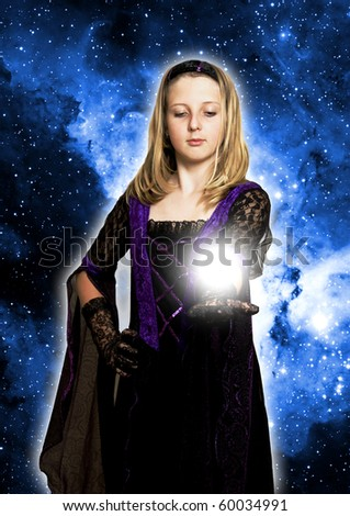 girl in gothic dress holding a light on her open hand - stock photo