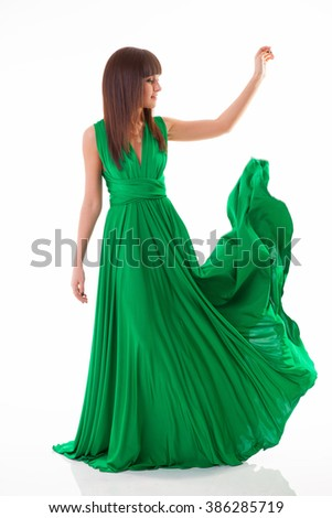 girl in green dress with straight hair - stock photo