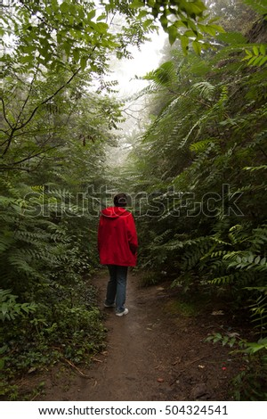 Girl in green forest
