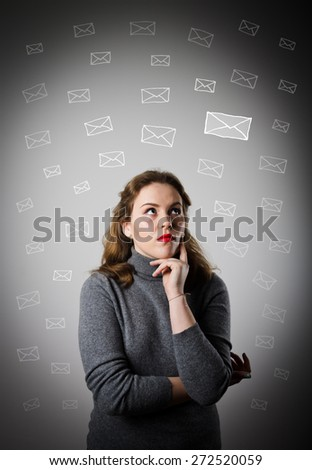 Girl in grey is looking at the letters. - stock photo