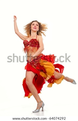 Girl in gypsy costume dancing over white background - stock photo