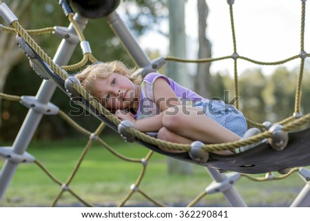 girl in hammock at playground