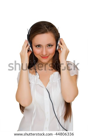 girl in headphones listens to music, looking straight . Isolated on white