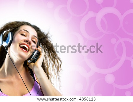 girl in headphones on a pink background
