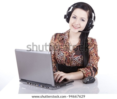 girl in headphones with a microphone and a laptop - stock photo