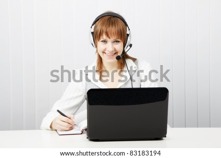 girl in headphones with a microphone. Worker Hotline - stock photo