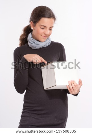 Girl in her early teens holding a blank box