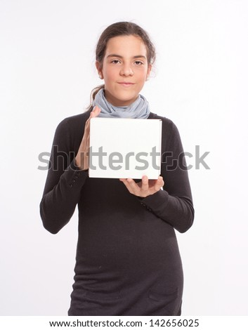 Girl in her early teens holding a blank box - stock photo