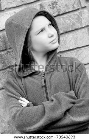 girl in hooded jacket outside - stock photo