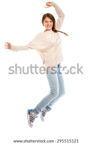 girl in jeans jumping on an isolated background - stock photo
