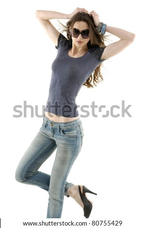 Girl in jeans, posing standing isolated