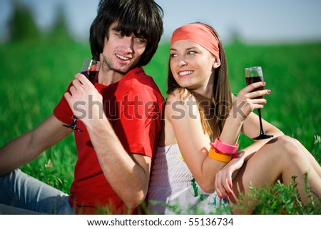 Girl in kerchief and boy with wineglasses - stock photo