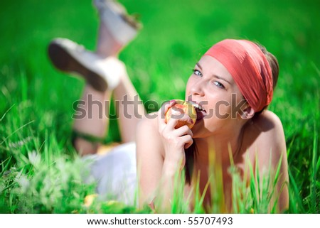 Girl in kerchief with apple - stock photo