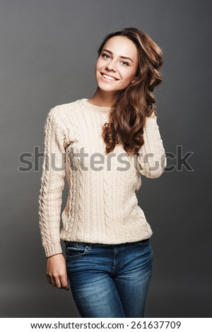 Girl in knitted sweater, makeup, wavy hair - stock photo