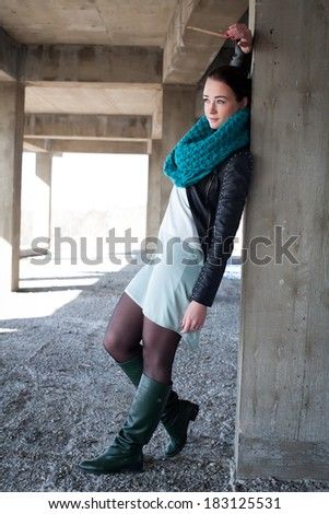 Girl in leather jacket worth of concrete structures