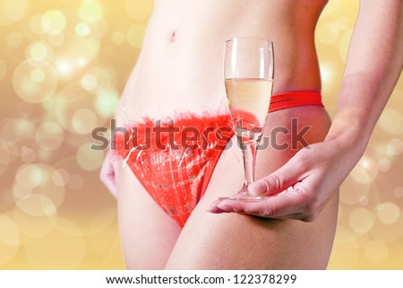 girl in lingerie with a flute of champagne - stock photo