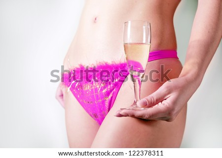 girl in lingerie with a flute of champagne