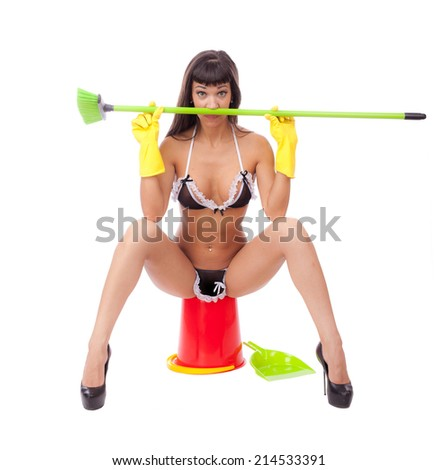 Girl in lingerie with broom on a white background.