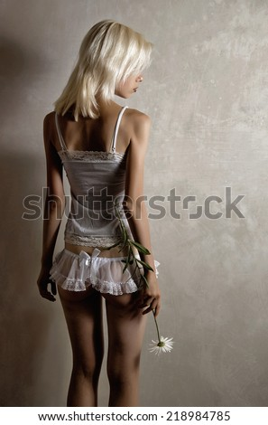 Girl in lingerie with flower - stock photo