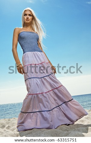 girl in long skirt on the seashore - stock photo