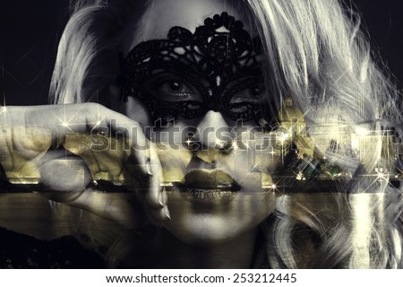 girl in mask looks through the window at night Prague. Photo with double exposure - stock photo